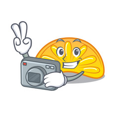 Photographer orange jelly candy mascot cartoon vector