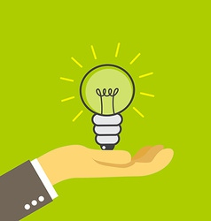 Lightbulb on the palm vector image vector image