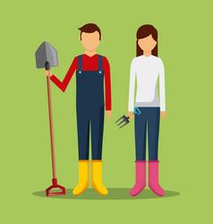 Gardeners couple holding shovel and pichfork tools vector