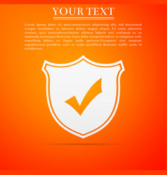 shield with check mark icon on orange background vector image