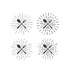 Fork and spoon with sunburst vector