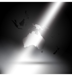 Australia map in rays of light on gray background vector image