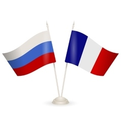 Table stand with flags of Russia and France vector image