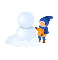 boy having fun making snowman isolated vector image
