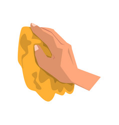 Human hand clean dirt with yellow rag vector