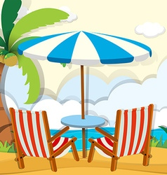 Chairs and umbrella on the beach vector