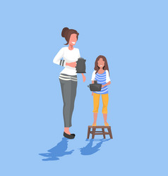mother with daughter holding kettle and pot family vector image