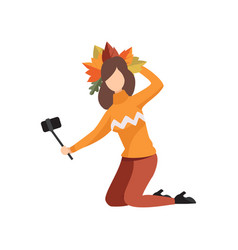 girl making selfie in a wreath of autumn leaves vector image
