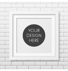 Realistic square white frame on the brick wall vector