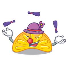 Juggling orange jelly candy mascot cartoon vector