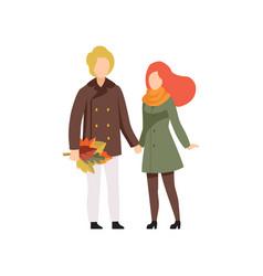 happy couple in autumn season clothes walking vector image