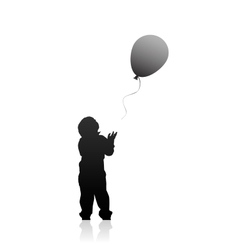 Silhouette of a boy with balloon vector image