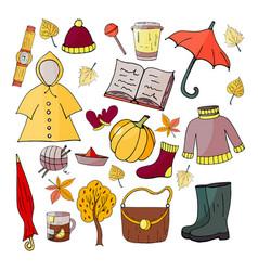 Set hand-drawn autumn elements on a white backg vector