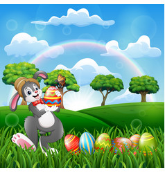 happy bunny holding a decorated easter egg vector image