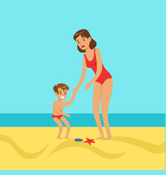 mother with her son walking on a beach vector image