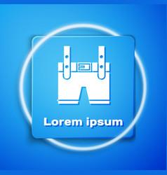 White lederhosen icon isolated on blue background vector
