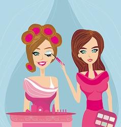 Professional make-up artist applying eyeshadow vector