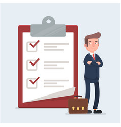 happy businessman looking at a completed checklist vector image