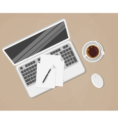 laptop and office supplies laying on the brown vector image