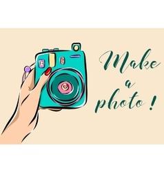 Hand holding a photo camera vector