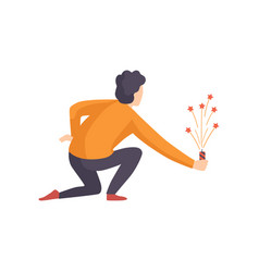 Young man launching fireworks rocket with sparkles vector