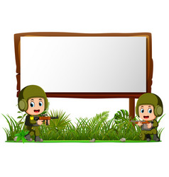 two soldiers by wooden signboard at the jungle vector image