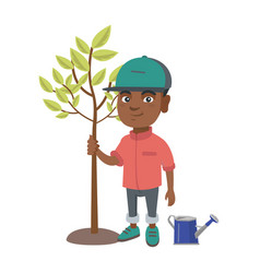 african-american smiling boy planting a tree vector image