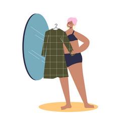 Beautiful plus size woman model trying dress vector