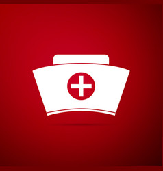 nurse hat with cross icon on red background vector image