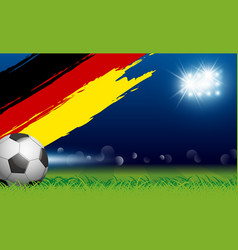 soccer ball on grass and paintbrush germany flag vector image