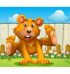 A bear playing near the wooden fence vector