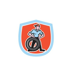 Tireman Mechanic With Tire Cartoon Shield vector