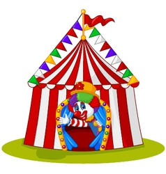 Cartoon clown come out from circus tent vector
