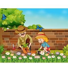 Girl and dad planting trees in the garden vector