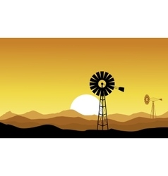 Silhouette of windmill on yellow backgrounds vector image