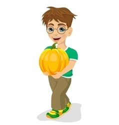 cute little boy carrying a large pumpkin smiling vector image vector image