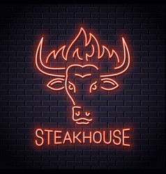bull head neon logo of steakhouse bull with fire vector image