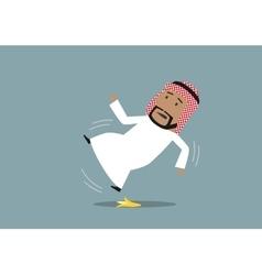 Arabian businessman slipped on a banana peel vector image