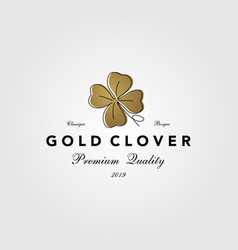 Vintage gold clover leaf logo icon vector