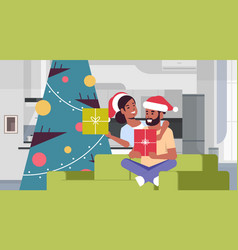 couple holding gift boxes merry christmas happy vector image