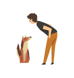 Male pet owner man training or playing with his vector