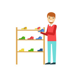 Smiling man holding a shoe in the shoe store vector