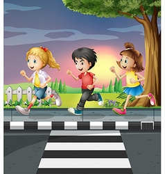 Three kids running along the road vector