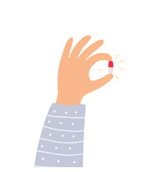 Hand holding magic pill vector