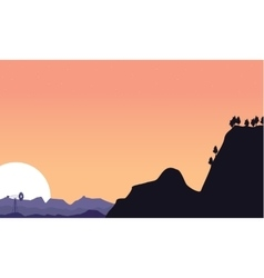 Silhouette of cliff and windmill scenery vector