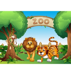 A monkey a lion and a tiger inside the wooden vector image vector image