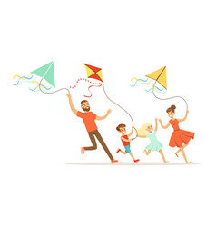 happy family with two kids having fun flying kites vector image
