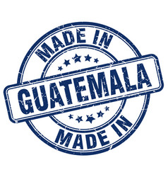 made in guatemala blue grunge round stamp vector image