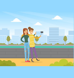 two young women making selfie on city street best vector image