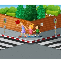 Woman helping kids crossing the street vector image